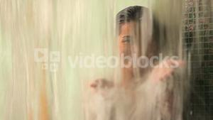 Woman playing with water in the shower