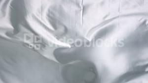 Silk bed sheet moving like waves