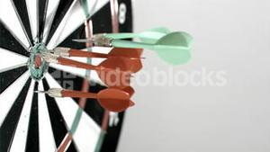 Darts going in the target