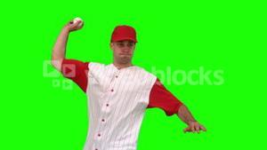 Brunette man throwing a baseball on green background