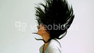 Woman shaking her hair upwards