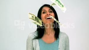Woman looking at money falling