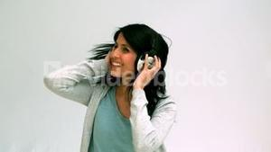Woman listening and dancing with headphones