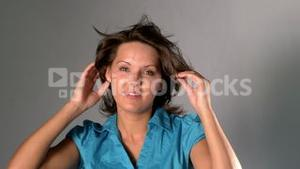 Woman tossing and touching her hair