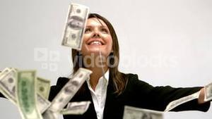 Money falling on businesswoman