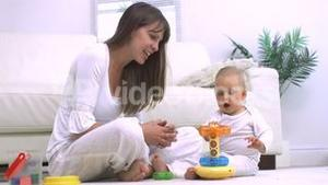 Mother and her child playing