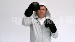 Man boxing with black gloves