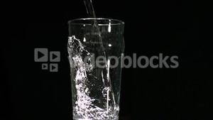 Water filling a pint glass