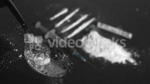 Drop falling on spoon with drug powder