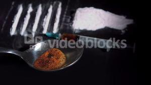 Spoon with drugs cooking