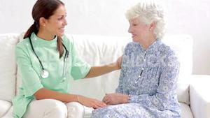 Elderly woman speaking with home nurse