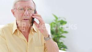 Senior calling with mobile phone