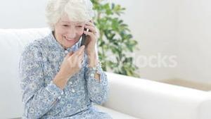 Old woman calling with mobile phone