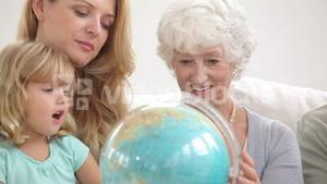 Family looking at a globe