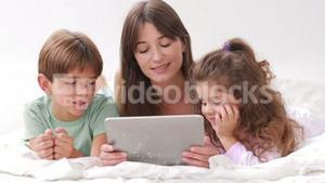 Mother and her children using tablet pc