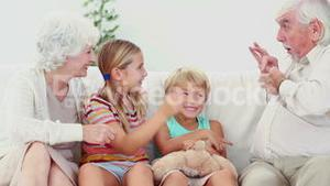 Children playing with grandparents