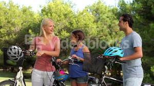 Discussing family with their bikes