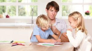 Siblings drawing with their father