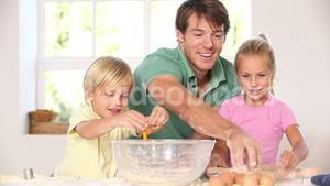 Father and children breaking eggs