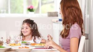 Mother touching hair his daughter a table