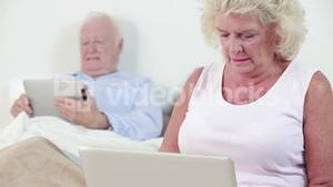 Old couple using technology