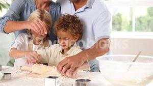 Mother and father baking with their children