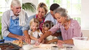 Extended family having fun while baking