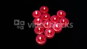 Burning candles in form of heart