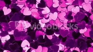 Purple heart shaped confetti changing color