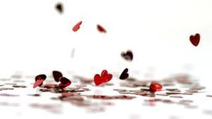 Red heart confettis falling down