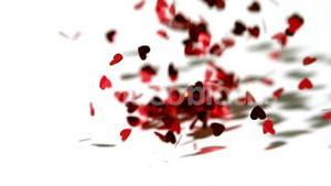 Lots of heart confetti falling on the floor