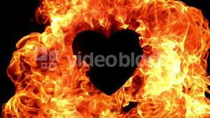 Flame of fire burning around a black heart