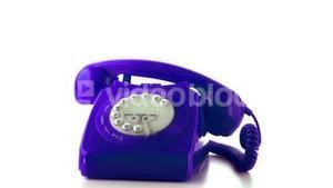 Receiver falling on purple dial phone