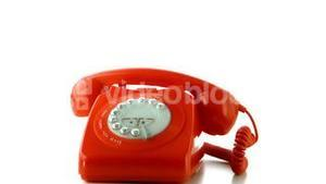 Receiver falling on red dial phone