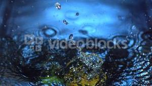 Lemon and lime falling into water
