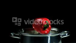 Red pepper falling into pot