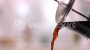 Cafetiere pouring coffee