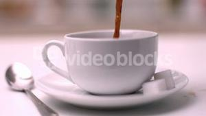 Coffee pouring into coffee cup