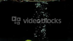 Lime dropping into water