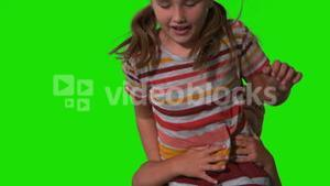 Siblings jumping up and down on green screen