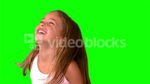 Close up of little girl laughing and turning on green screen