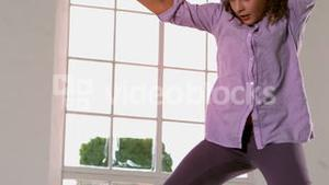 Happy girl jumping up and down in front of window