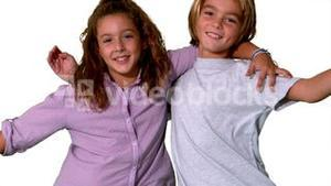 Brother and sister jumping into same shot and embracing