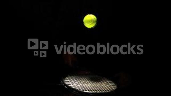 Tennis Ball Bouncing On A Racket On Black Background Stock Video