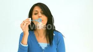 Woman making bubbles with a bubble wand