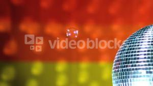 Shiny disco ball revolving with floating bubbles against rainbow flag