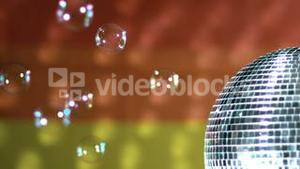 Shiny disco ball spinning with floating bubbles against rainbow flag