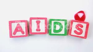 Aids spelled out in blocks with red ribbon
