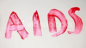 Aids in red paint being crossed out
