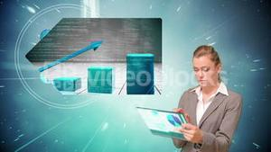 Businesswoman using touchscreen with projection